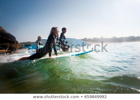 Four people going out to surf smiling Stock photo © IS2