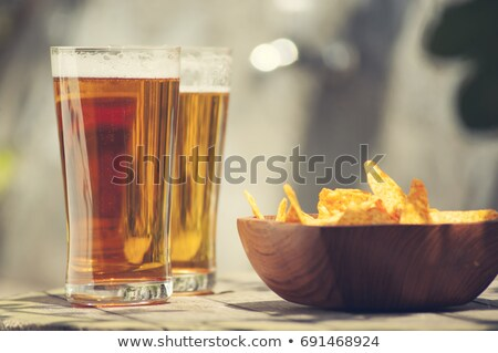 Glass of beer and nacho chips Stock photo © dash