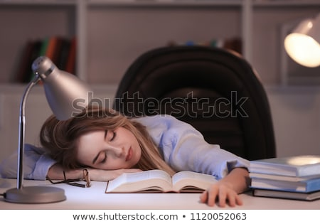 student or woman sleeping on table at night home Stock photo © dolgachov