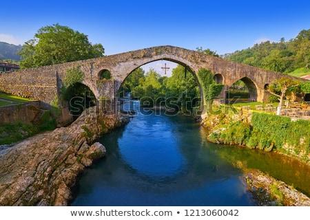 Római híd Spanyolország folyó égbolt víz Stock fotó © lunamarina