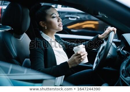 Businesswoman drinking takeaway coffee in car Stock photo © Kzenon