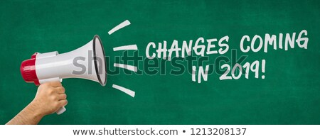 A man holding a megaphone - Changes coming in 2019 Stock photo © Zerbor