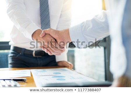 sealing a deal business people shaking hands after welcoming pa stock photo © snowing