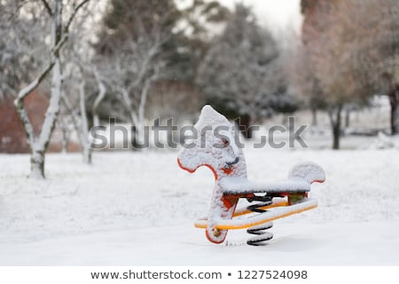 Playground equipment rocking horse covered in snow Stock photo © lovleah