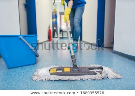 schoonmaken · vloer · gelukkig · vrouwelijke · kantoor - stockfoto © andreypopov