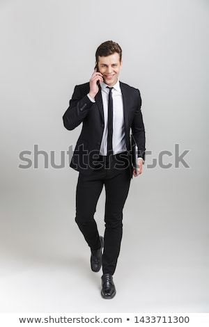 glimlachend · jonge · zakenman · permanente · geïsoleerd - stockfoto © deandrobot