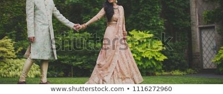 image of a groom holding bridal shoes Stock photo © ruslanshramko