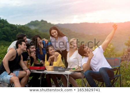 friends taking selfie by smartphone at picnic Stock photo © dolgachov