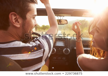 happy man driving convertible car Stock photo © dolgachov