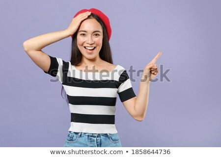 Retrato encantado mulher jovem boina em pé Foto stock © deandrobot