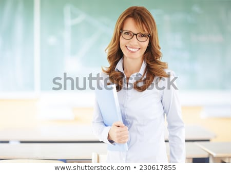 Students with books and teacher standing in school class Stock photo © Kzenon