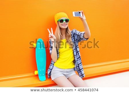 Skateboard toma células deporte ocio Foto stock © dolgachov