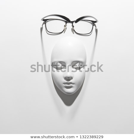 Stylish glasses with black frame for reading daily life on a gypsum face sculpture on a white backgr Stock photo © artjazz