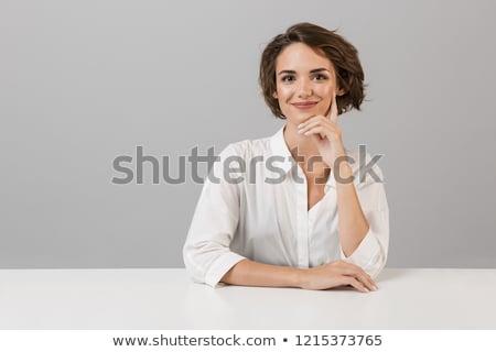 Donna d'affari posa isolato grigio muro seduta Foto d'archivio © deandrobot