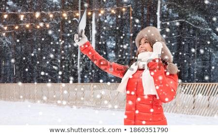 Nő tél szőr kalap táblagép kint Stock fotó © dolgachov