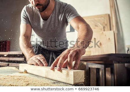 Carpenter working in furniture factory on machine Foto stock © Kzenon