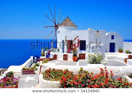 window with windmill of Oia, Santorini Stock fotó © neirfy