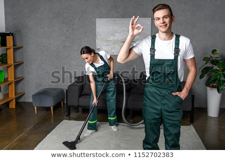 Young attractive man is cleaning vacuum commercial cleaning equi Stock fotó © snowing