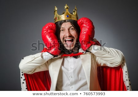 funny businessman with crown and boxing gloves stock photo © elnur