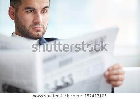 Attractive businessman reading newspaper Stock photo © deandrobot