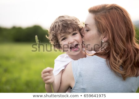 cute kid boy with his mother on a summer meadow stock photo © lopolo