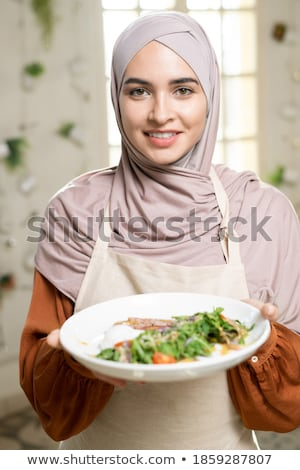Head and shoulders of young islamic female in hijab Stock photo © pressmaster