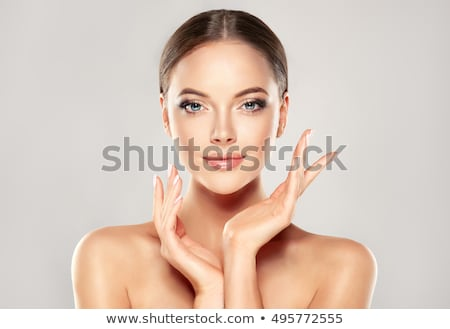 Beauty face. Beautiful Young Woman with Clean Fresh Skin touch own face and body. Facial treatment.  Stock photo © serdechny