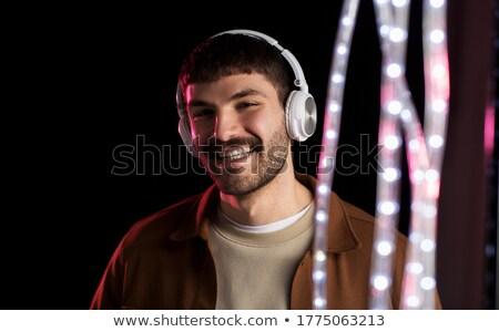 Adam kulaklık neon ışıklar gece klübü müzik Stok fotoğraf © dolgachov