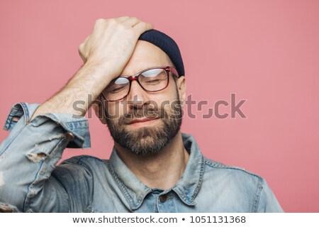 Portré lehangolt középkorú férfi szemek kéz Stock fotó © vkstudio