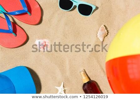 Sapka papucs strandlabda homok vakáció nyár Stock fotó © dolgachov