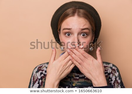 Photo of pretty scared woman expressing shock and covering her mouth Stock photo © deandrobot