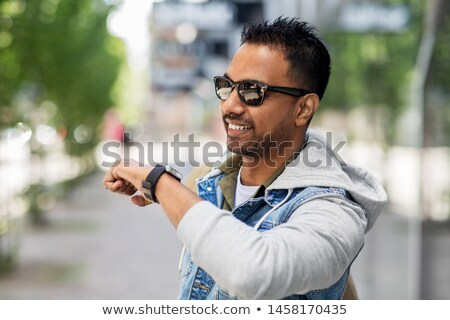 indian man recording voice message by smart watch Stock photo © dolgachov