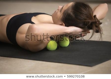 beautiful woman fitness routine using gym ball stock photo © darrinhenry