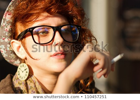 Portrait of a beautiful woman smokes a cigarette outdoor at cafe Stock photo © HASLOO