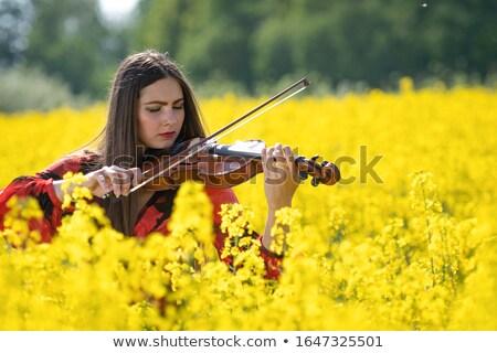 Foto stock: Pretty Woman In Yellow Rape Field