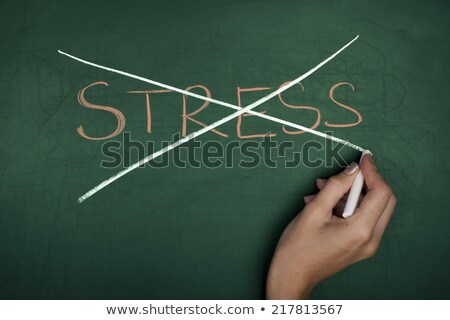 Crossing out stress and writing relax on a blackboard. stock photo © latent
