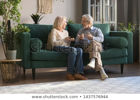 friendly mature couple in a lounge Stock photo © photography33