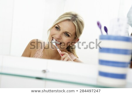 Foto stock: Woman Looking A Toothbrush
