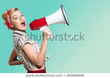 Studio shot of a girl shouting into a megaphone Stock photo © photography33