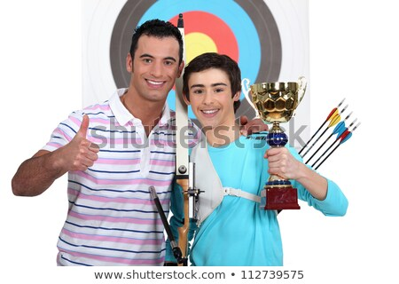 Proud team of archers posing with their trophy Stock photo © photography33