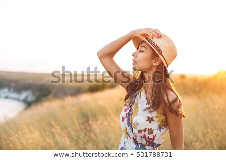 Asian indian woman walking outdoors in golden field Stock photo © lunamarina