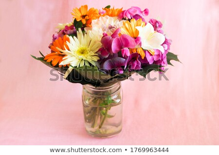 Bouquet of orange, pink and red flowers Stock photo © boroda