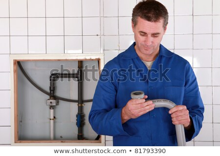 Skilled worker replacing defective pipe Stock photo © photography33