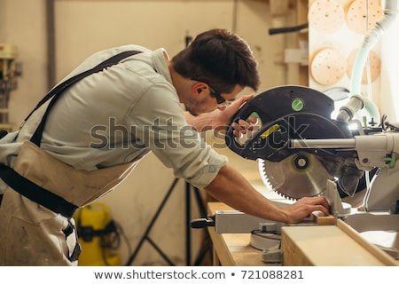 Man sawing plank of parquet Stock photo © photography33