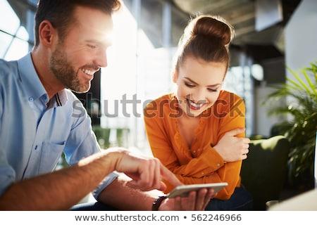 iş · çift · bakıyor · dizüstü · bilgisayar · bilgisayar · ofis - stok fotoğraf © photography33