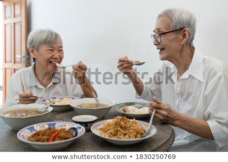 Elderly woman eating balanced breakfast Stock photo © photography33