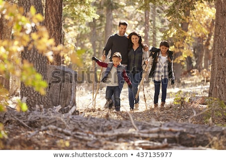 Family with two daughters in autumn forest Stock photo © dashapetrenko