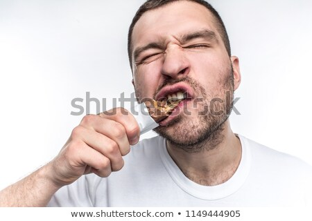 Excited man eating chocolate bar Stock photo © photography33