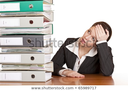 Stock photo: business woman in office looks at unbelievable folder stack