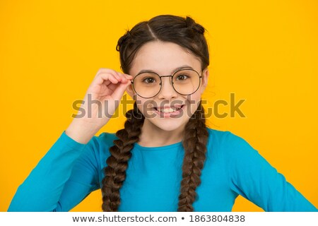Teen girl with pigtails wearing glasses Stock photo © RuslanOmega